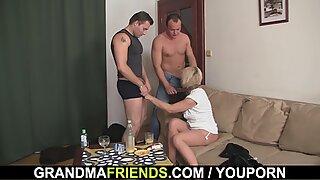 Hot blonde grandma enjoys two fresh cocks